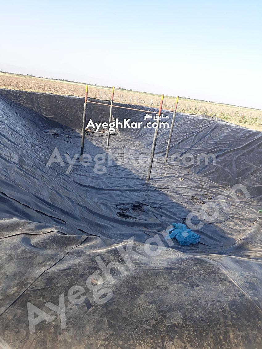 استخر ژئوممبران ذخیره آب کشاورزی آقای آشوری در قزوین بوئین زهرا